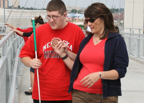 Young man who has deaf-blindness at pier with mother