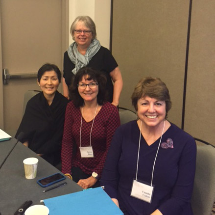 Laurie Dinnebeil (standing), from left to right Chih-ing Lim, Patricia Blasco, and Camille Catlett