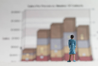 illustration of person standing in front of graph
