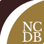 NCDB Logo - a square with a black upper left corner, a white swoosh across the middel, and a brown lower right corner with NCDB in block letters