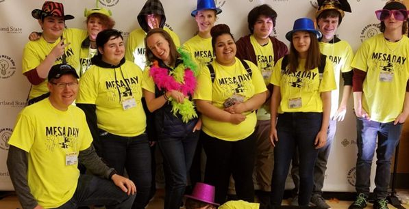 Students wearing yellow Mesa Day shirts