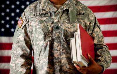 Soldier carrying textbooks